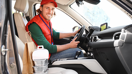 man sitting in the drivers seat of a commercial vehicle