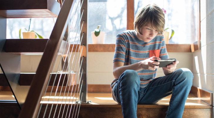 boy using mobile device