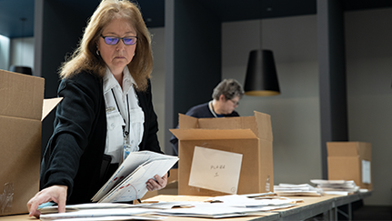 woman working in a mail room