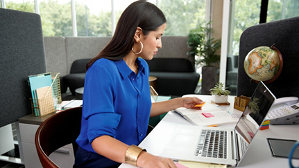 woman sitting at a desk in an office