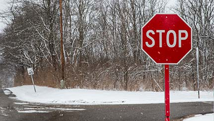 Stop sign near snowy road