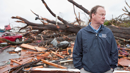 A man surveys damage from a natural disaster