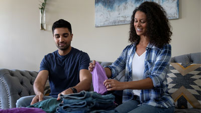Couple folding laundry