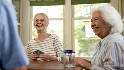 Senior women playing cards