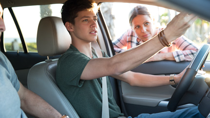 teenager in car with parents