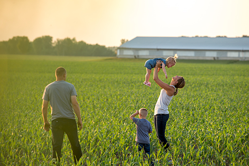 family playing in field