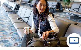 Woman with a visa sitting in an airport