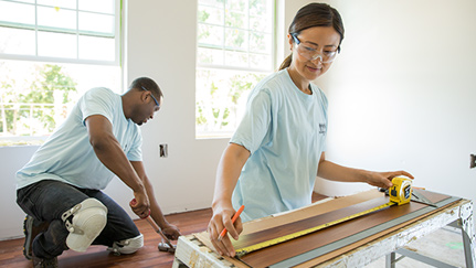 Man and woman doing a flooring home improvement project