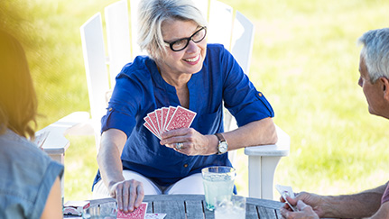 Empty nesters playing cards on a patio