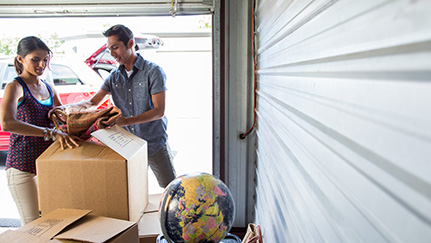 couple in a garage packing up their belongings