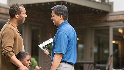 Man standing with his daughter talking to a real estate agent about dual agency