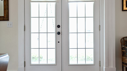 Doors Of A House Equipped With A Home Security System